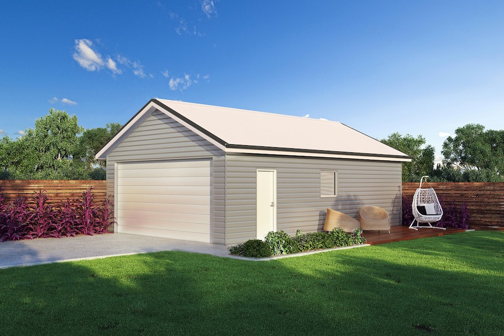 A light gray prefabricated steel garage with a white roof purchased from Titan Steel Structures by a hard working family man